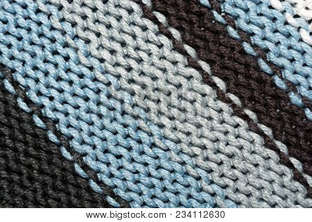Texture Of Knitted Fabric. Stranded Threads. Cloth Of Warm Winter Clothes. Warm Blanket. The Texture