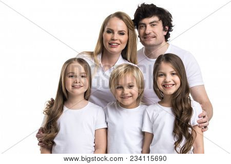 Portrait of happy smiling family of two parents and three children isolated on white background