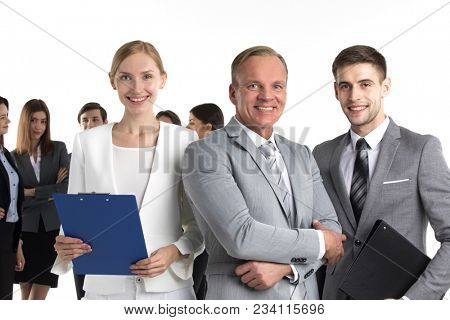 Portrait of business leaders and their team isolated on white background