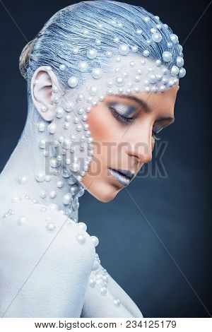 Fantasy Make-up. Portrait Of Beautiful Woman With Fantasy Make-up With White Pearls On A Dark Backgr