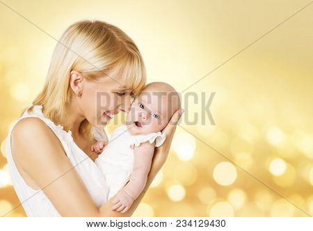 Mother And Baby, Mom Hold Newborn Kid On Hands, Happy Woman With New Born Girl One Month Old