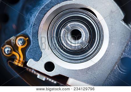 Closeup Inside The Hard Drive, Macro Photo Of Hdd Actuator Axis