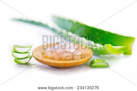 Aloe Vera gel closeup. Sliced aloevera leaf and gel, natural organic cosmetic ingredients for sensitive skin, alternative medicine. Organic Skin care concept. Isolated on white background