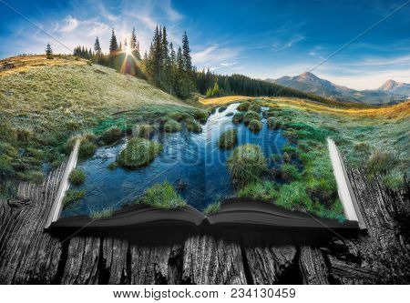 Alpine Mountain Valley In A Light Of Sunrise On The Pages Of An Open Magical Book. Majestic Landscap