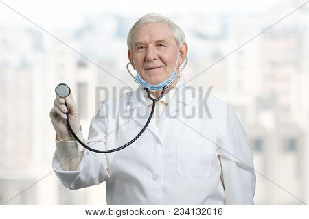 Male Doctor With A Stethoscope Listening. Senior Caucasian Doctor Checking Your Health And Heartbeat