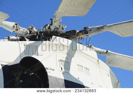 Photo Of A Propeller Plane Against A Blue Sky Background