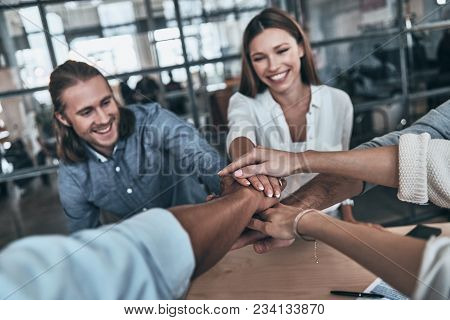 Best Team. Top View Of Business Colleagues Holding Hands On Top Of One Another In A Symbol Of Unity
