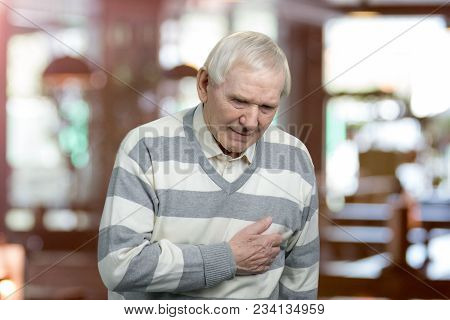 Old Man Holding Breast Because Of Heart Infarction. Painful Senior Man With Pain On Heart, Heart Att