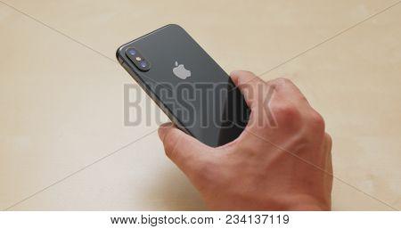 Hong Kong, Hong Kong, 01 March 2018:- Hand holding IphoneX