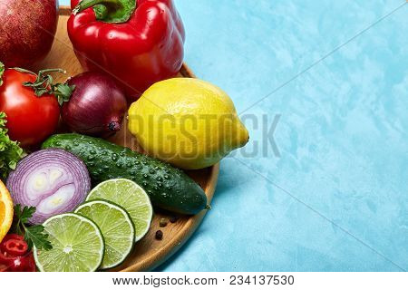 Colorful Still Life Of Fresh Organic Fruits And Vegetables On Wooden Plate Over Blue Background, Sel