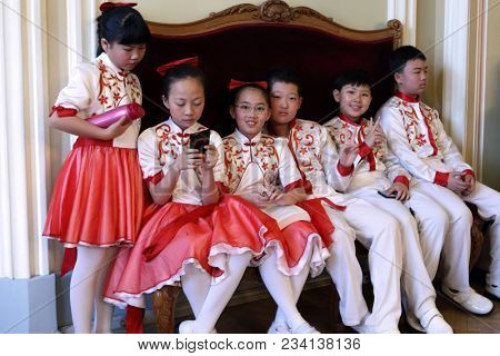 SAINT-PETERSBURG, RUSSIA - FEBRUARY 25, 2018: Children from Xiaman Media Group Students' Choir Happy Childhood, China have a break during V Children and Youth World Choral Championship