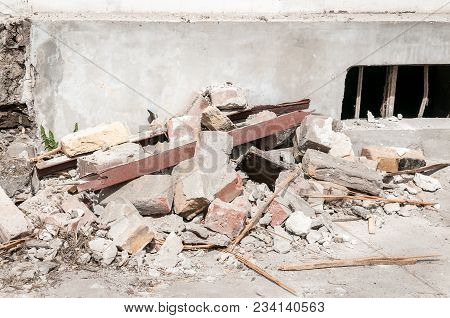 Destruction. Demolition And Destruction Site Bricks Remains Of Building Material On The Ground By Th