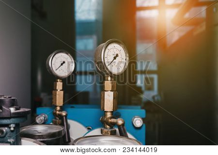 Closeup Of Manometer, Measuring Gas Pressure. Pipes And Valves At Industrial Plant.pressure Gauge, M
