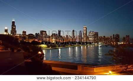 Chicago Skyline Cityscape At Sunset Under A Clear Blue Sky As Seen From Museum Campus In Summer With