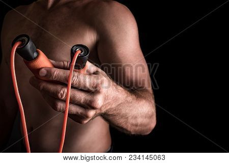 Adult Caucasian Male With Skipping Rope In His Hands Passing It To The Viewer.