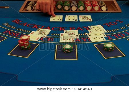 Dealer Distributes Cards On Blackjack Table