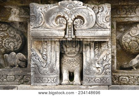 Ancient stone bas-relief with lion and parrot, Buddist temple Borobudur, Yogyakarta, Central Java, Indonesia. UNESCO world heritage site