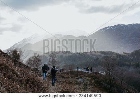 Glenfinnan, Scotland - March 17, 2018: People On A Viewing Platform Near Glenfinnan Viaduct, Scotlan