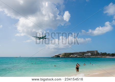 Philipsburg, Sint Maarten - February 13, 2016: Plane Land Over Maho Beach. Jet Flight Low Fly In Clo