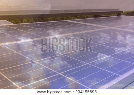 Double Exposure Solar Energy Panel Photovoltaics Module With Cloud Reflection.