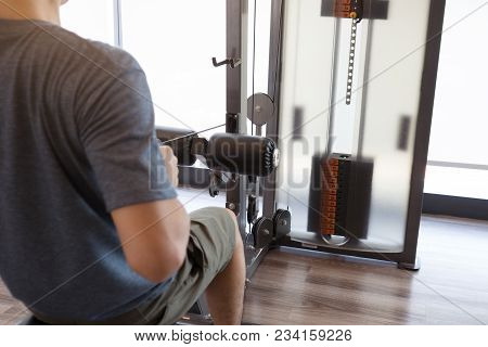 A Man Workout Beginner  For Muscles At Gym. Healthy Lifestyle Concept.