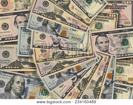 Fan Of American Dollar Bills Money Of Various Currencies In Close Up On Background Of Pile Of Dollar