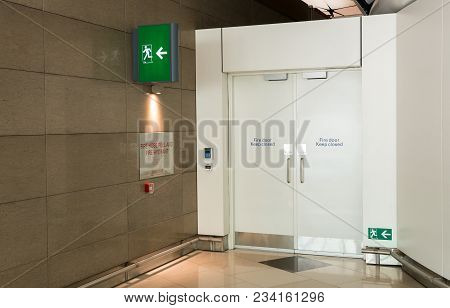 Fire Exit Way Door And Fire Exit Sign Lightbox In The Airport Terminal Emergency Exit Way. Green Eme
