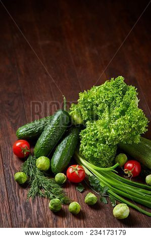 Fresh Vegetables Composition Over Wooden Background, Close-up, Flat Lay. Assortment Of Fresh Vegetab