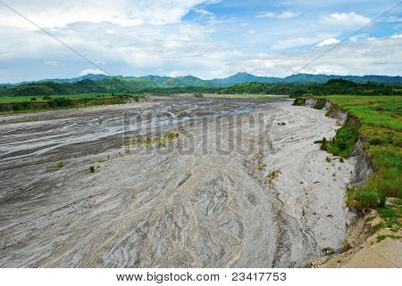 Volcanic Ashes Over a River