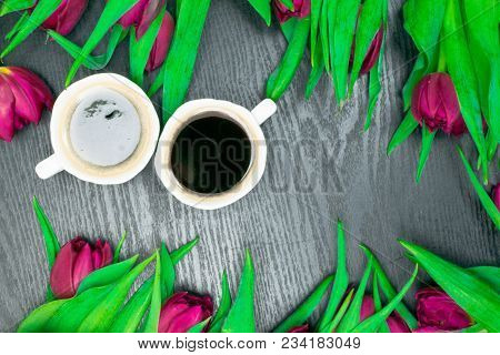 Beautiful Fresh Spring Tulip With Cup Of Cofee On Dark Background. Coffee Time. Flower Gift