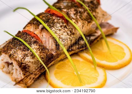Close Up Plate With Pike Perch Fillet, Lemon, Tomato And Asparagus. Healthy Diet Concept