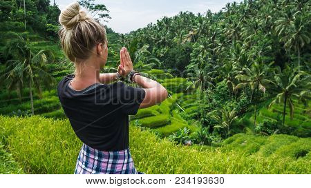 Female Meditating On Tegalalang Rice Terrace, Ubud - Bali. Indonesia