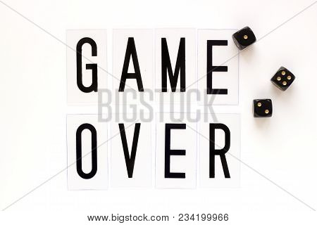 Game Over Text With Gaming Dice On White Background. Concept For Banners, Web Pages, Games, Presenta