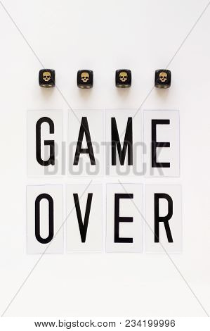 Game Over Text And Gaming Dice With Image Skull On White Background. Concept For Banners, Web Pages,