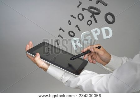 RGPD, Spanish, French and Italian version version of GDPR: Reglamento General de Proteccion de datos. General Data Protection Regulation. Young man working with information.
