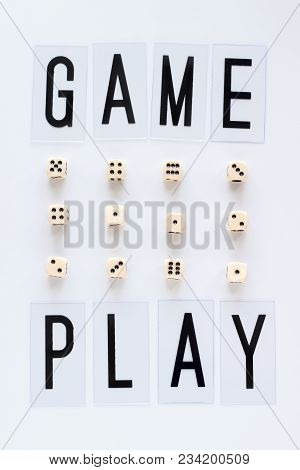 Game Play Words And Gaming Dice In Row On White Background. Concept For Banners, Web Pages, Games, G