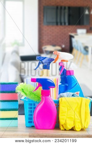 Spring Cleaning Concept - Colorful Spays And Rubbers On Wooden Table In Apartment