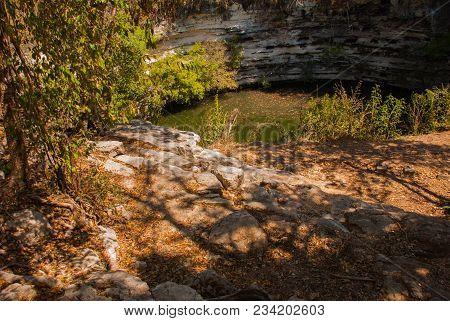 Cenote Is Located On The Territory Of The Pyramids. Yucatan. Chichen Itza In Mexico.