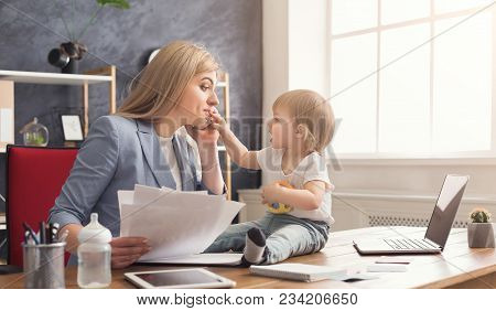 Happy Beautiful Business Mom Talking On Smartphone And Working With Documents In Office While Her Cu