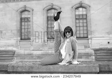 Happy Girl Do Leg Split Stretching Exercise On Stone Fence On House Facade. Yoga, Pilates, Fitness,