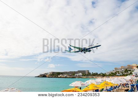 Philipsburg, Sint Maarten - January 24, 2016: Jet Flight Low Fly Over Maho Beach. Plane Land On Clou