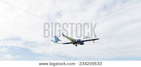 Philipsburg, Sint Maarten - January 24, 2016: Jet On Flight In Clouds. Aircraft Fly On Cloudy Sky. P