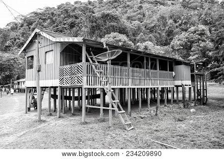 Boca De Valeria, Brazil - December 03, 2015: Hut On Wooden Piles In Village In Jungles On Natural Ba