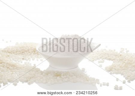 White Gluten-free Rice Flour In Bowl With Rice Isolated On White Background.