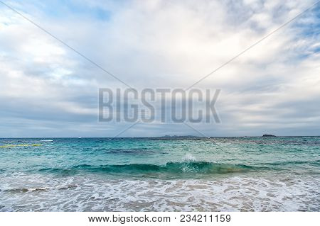 Sea Waves On Cloudy Sky In Philipsburg, Sint Maarten. Seascape And Sky With Clouds, White Cloudscape
