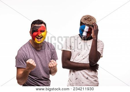 Happy Football Fan Of Germany Celebrate Win Over Upset Football Fan Of France National Teams With Pa