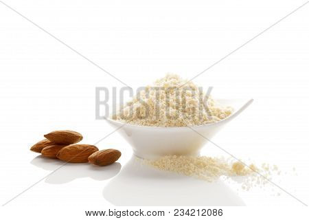 Almond Flour In Bowl And Almonds Isolated On White Background.