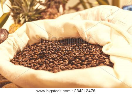 Bag Of Roasted Coffee Beans On The Market In South America. Vintage Toning Effect. Stock Photo