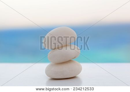 Zen rock stack on tropical beach. Zen, simplicity, spirituality and balance concept. poster