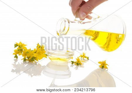 Pouring St. John's Wort Oil Extract